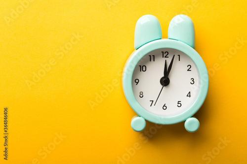 Obraz Clock Isolated On Yellow Background - fototapety do salonu