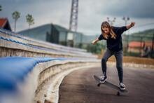 Teenage Girl Performing Skateb...