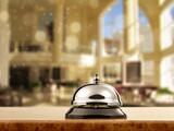 Fototapeta Kawa jest smaczna - Vintage hotel reception service bell on the desk.