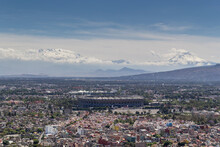 Aerial View Of Azteca Soccer Stadium And Iconic Snowed Volcanoes In The Back