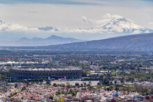 Aerial View Of Azteca Stadium And Iconic Snowed Volcanoes In The Back