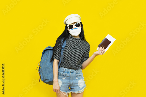 Young Asian female tourist wearing mask of new normal lifestyle Fototapeta
