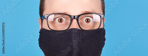 Fotografie, Obraz Angry brunette man in protection mask screaming, rage and mad expression