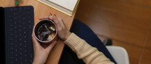 Female Hands Holding Ice Coffe...