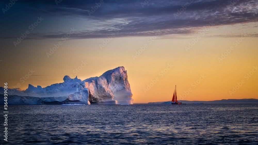 Fototapeta Greenland Ilulissat glaciers at ocean with red sailing boat