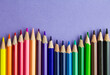 Set of colorful pencils on purple background. Copy space for text.