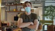 cafe or restaurants and business reopen after coronavirus quarantine is over. portrait of man with face medical mask, owner barman. small business post covid lockdown.