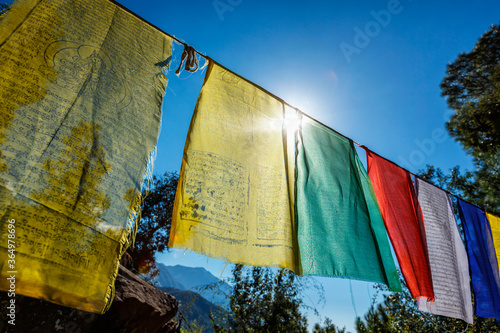 Fotografering Prayer flags of Tibetan Buddhism with Buddhist mantra on it in Dharamshala monastery temple