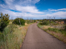 Active Lifestyle Image Of A Mother And Daughter Walking On An Access Road On A Mesa Top In South Western Colorado.
