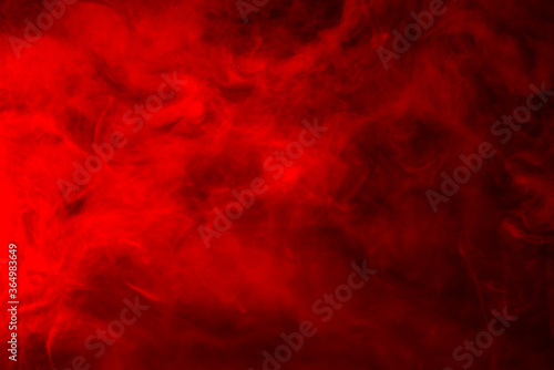 Red smoke on a black background, abstract background Fototapeta