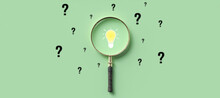 Magnifying Glass With Lightbulb As Symbol For Finding A Solution On Light Green Background