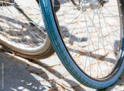 retro bicycle wheel on the grey brick road, city lifestyle outdoor Fototapete