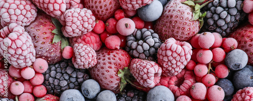 Fotografía Mix of different frozen berries as background, banner design