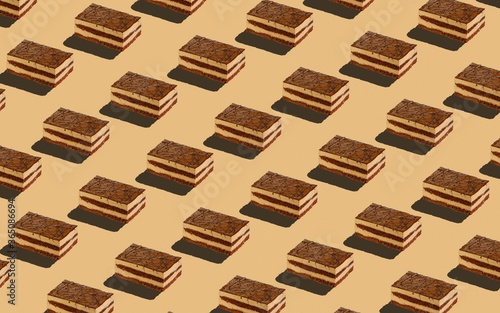 Fotografia Trendy seamless food pattern - layered sponge cakes on a pastel background, minimal food isometric concept texture