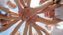 Friendly Friends Clasp Hands As A Sign Of Strong Friendship And Teamwork.