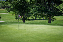 Golfing Green With American Flag Cup Flag