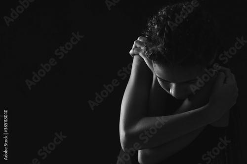 Photo Sad African-American girl on dark background. Stop racism