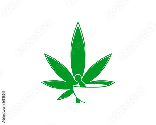 Photo Green cannabis leaf with mortar and pestle