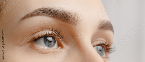Canvas-taulu Young woman with beautiful eyebrows. Correction of brow hair