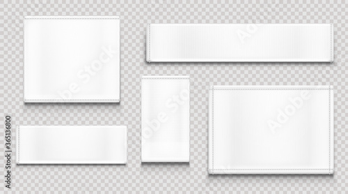 Obraz White fabric tags different shapes isolated on transparent background. Vector realistic mockup of blank cloth labels with stitches, cotton badge for textile, woven fashion sticker - fototapety do salonu