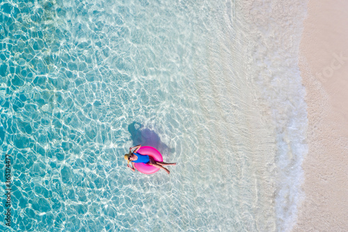 Fototapeta Top above high angle aerial drone view of her she attractive girl floating on rubber ring in transparent ocean water coastline sunny weather spending season luxury place summertime daydream obraz