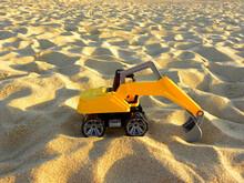 Yellow Plastic Excavator In Th...