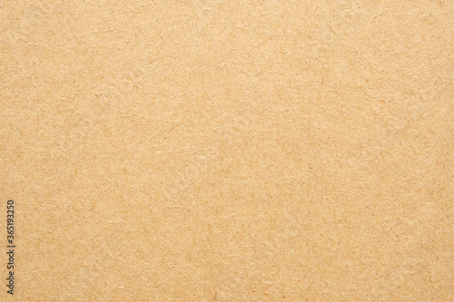 Foto Brown eco recycled kraft paper sheet texture cardboard background