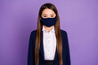 canvas print picture - Portrait of her she nice attractive lovely long-haired schoolchild diligent learner wearing textile cotton safety reusable mask mers cov prevention isolated on violet lilac purple color background