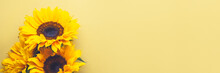 Yellow Sunflower Bouquet On Bright Yellow Background, Autumn Concept, Top View, Space For Text, Banner Size