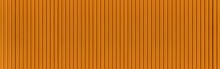 Panorama Of Modern Yellow Stone Wall With Stripes Texture And Seamless Background