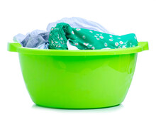 Green Plastic Bowl With Laundry On White Background Isolation
