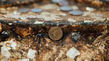 Close-up Of Coin On Rock