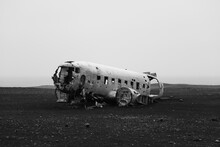 Damaged Airplane On Field Agai...
