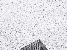 Low Angle View Of Sky Seen Through Wet Glass Window