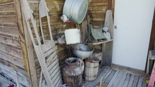 Antique Items On The Back Porch Of An Old Abandoned Cabin In The Old West