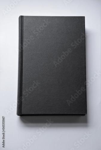 Fotografering Black blank hardcover book on white background