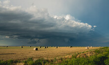Bales Of Hay And Storm Clouds