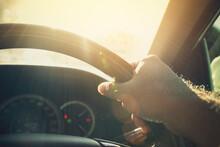A Man Driving Car In Sunlight ...