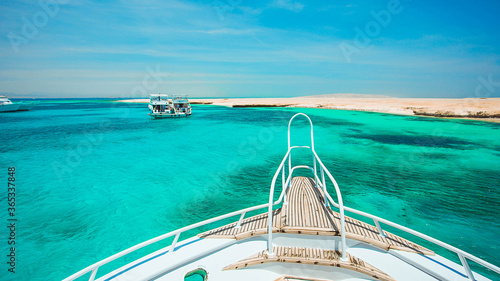 View from the yacht to the turquoise sea and island