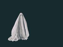 Halloween Ghost In A Sheet On Dark Background