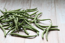 Green Beans On A Wooden Backgr...