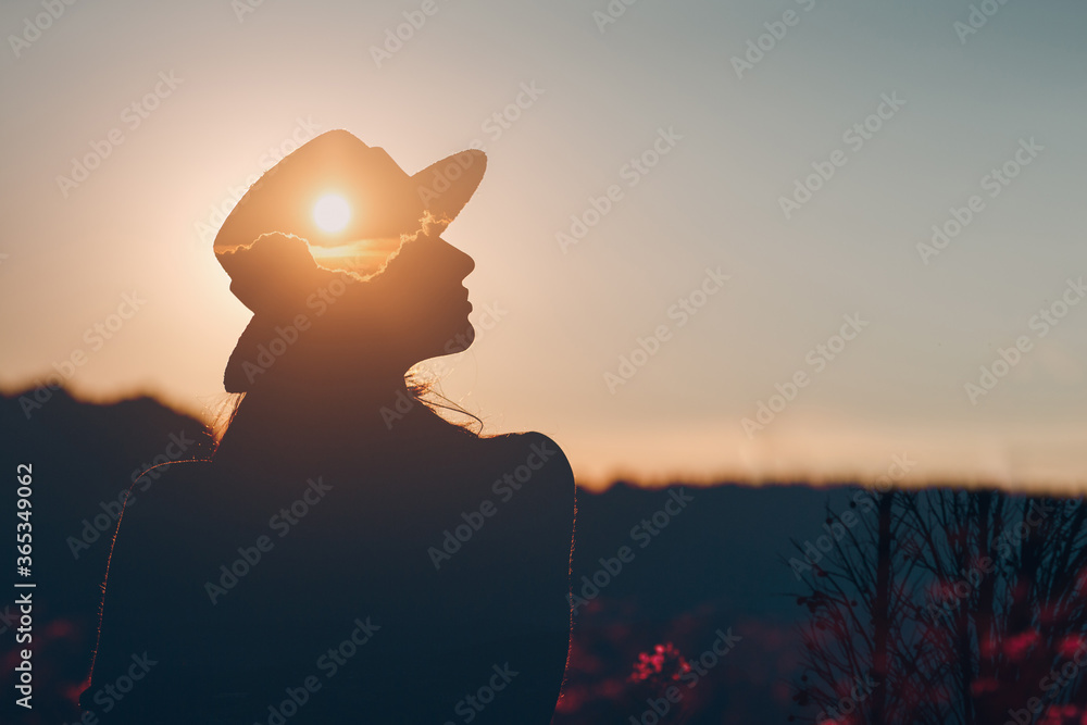 Fototapeta Mental health and business. Silhouette of young adult businesswoman