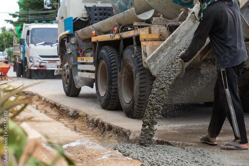 Obraz na plátně Mixed concrete pouring at construction site