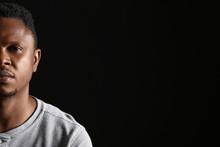 Sad African-American Man On Dark Background. Stop Racism