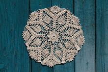 Beautiful Crochet Doily On Blue Wooden Background