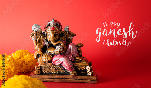 Happy Ganesh Chaturthi festival, Bronze Ganesha statue and Golden texture with flowers, Ganesh is hindu god of Success Wallpaper Mural