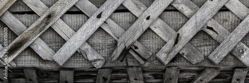 Old broken wall with a wooden crate Canvas Print