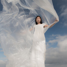 Girl In White Dress With Plast...