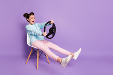 Portrait Of Her She Nice-looking Attractive Funny Glad Cheerful Cheery Girl Sitting On Chair Holding In Hands Steering Wheel Like Driving Car Isolated On Violet Purple Lilac Pastel Color Background