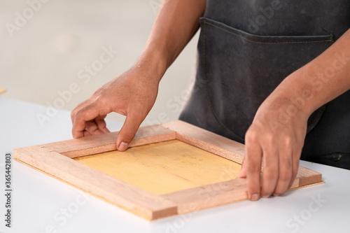 Fototapeta Process of gluing plank of plywood obraz